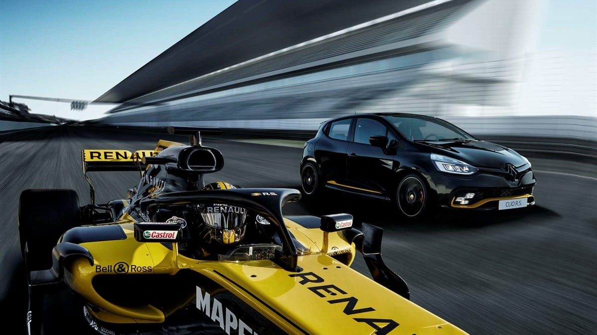 Renault Clio RS on race track with F1 racing car